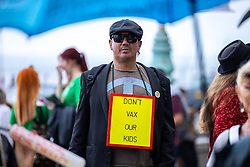 © Licensed to London News Pictures. 25/09/2021. Brighton, UK. Anti vaccine conspiracist outside the conference . The first day of the 2021 Labour Party Conference , which is taking place at the Brighton Centre . Photo credit: Joel Goodman/LNP