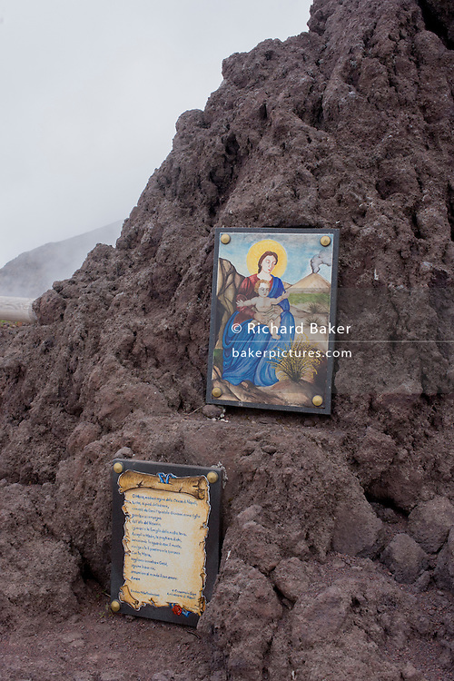 Religious shrine and old lava on the crater edge of Vesuvius volcano, Italy. <br /> <br /> From the chapter entitled 'Under the Volcano' and from the book 'Risk Wise: Nine Everyday Adventures' by Polly Morland (Allianz, The School of Life, Profile Books, 2014).
