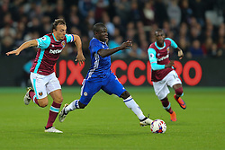 26 October 2016 - EFL Cup - 4th Round - West Ham v Chelsea - Ngolo Kante of Chelsea chased by Mark Noble of West Ham - Photo: Marc Atkins / Offside.
