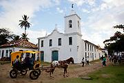 Capela de Nossa Senhora das Dores - Chapel of Our Lady of Sorrows with a horse and trap cart in front of it, Paraty, Rio de Janeiro, Brazil.