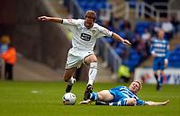 Photo: Alan Crowhurst.<br />Reading v Leeds Utd. Coca Cola Championship.<br />29/10/2005. Leeds' Eddie Lewis (L) beats Brynjar Gunnarsson to the ball.