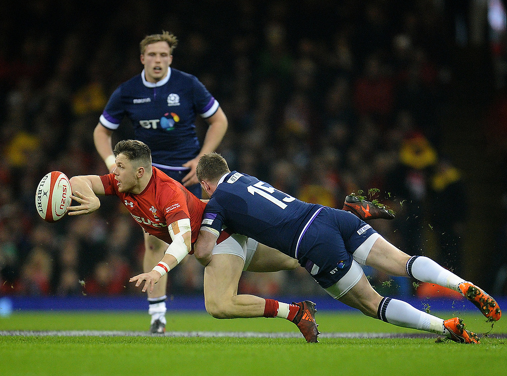 Wales' Steff Evans is tackled by Scotland's Stuart Hogg<br /> <br /> Photographer Ashley Crowden/CameraSport<br /> <br /> NatWest Six Nations Championship - Wales v Scotland - Saturday 3rd February 2018 - Principality Stadium, Cardiff<br /> <br /> World Copyright © 2018 CameraSport. All rights reserved. 43 Linden Ave. Countesthorpe. Leicester. England. LE8 5PG - Tel: +44 (0) 116 277 4147 - admin@camerasport.com - www.camerasport.com