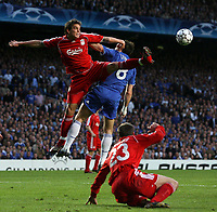 Photo: Paul Thomas.<br /> Chelsea v Liverpool. UEFA Champions League. Semi Final, 1st Leg. 25/04/2007.<br /> <br /> Daniel Agger (L) battles with Frank Lampard in the air.