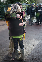 Harefield, UK. 16 January, 2020. A woman greets Stop HS2 activist Quercus after he left the Harvil Road wildlife protection camp in the Colne Valley voluntarily after a day and a night spent high up in a tree in woodland. 108 ancient woodlands are set to be destroyed by the high-speed rail link and further destruction of trees for HS2 in the Harvil Road area is believed to be imminent.