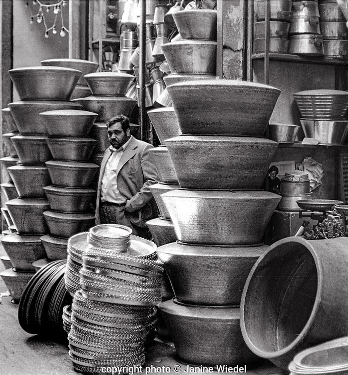 Traders with large hndmade pot in Tehran Bazaar Iran 1980s