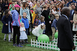WASHINGTON, DC - APRIL 02: (AFP OUT) U.S. first lady Melania Trump watches as children participate in the lawn bowling activity during the 140th annual Easter Egg Roll on the South Lawn of the White House April 2, 2018 in Washington, DC. The White House said they are expecting 30,000 children and adults to participate in the annual tradition of rolling colored eggs down the White House lawn that was started by President Rutherford B. Hayes in 1878. (Photo by Chip Somodevilla/Getty Images)
