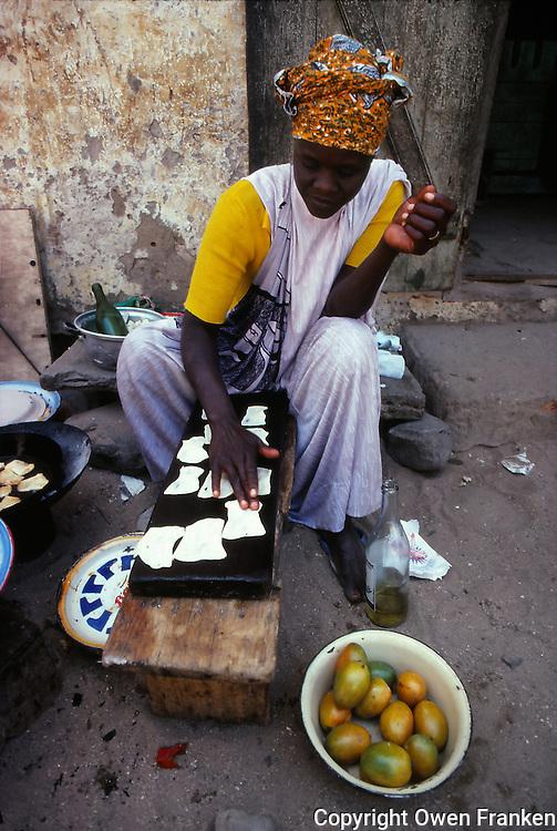 women cooking street food, Dakar