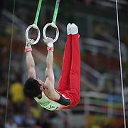 Gymnastics - Olympics: Day 3   Kohei Uchimura #154 of Japan performing his Still Rings routine during the Artistic Gymnastics Men's Team Final at the Rio Olympic Arena on August 8, 2016 in Rio de Janeiro, Brazil. (Photo by Tim Clayton/Corbis via Getty Images)