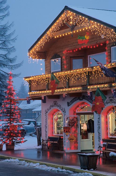 North America, USA, Washington, Leavenworth. Christmas lights add festive air to Front Street at dusk