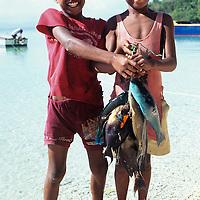 Fiji Islands, Yanuca Island, native boy islanders with fresh reef fish catch