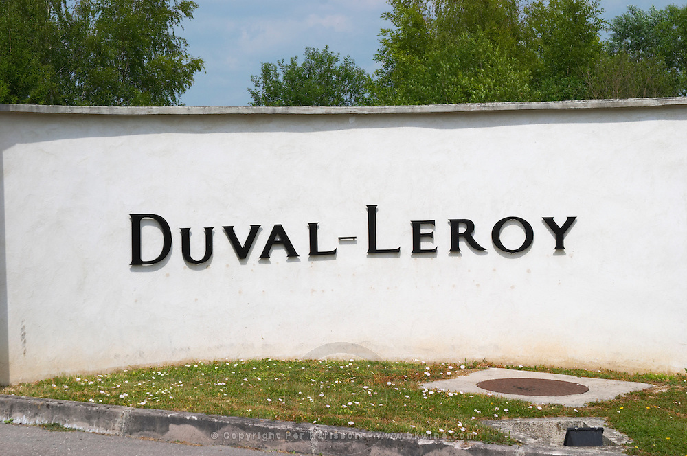 A sign at the gate in black letters on a white wall saying Duval-Leroy Champagne Duval Leroy, Vertus, Cotes des Blancs, Champagne, Marne, Ardennes, France