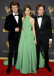 69th Annual Primetime Emmy Awards at Microsoft Theater on September 17, 2017 in Los Angeles, California. 17 Sep 2017 Pictured: Natalia Dyer, Joe Keery and Charlie Heaton. Photo credit: MEGA TheMegaAgency.com +1 888 505 6342
