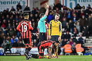 Arsenal Midfielder, Aaron Ramsey (8) is shown the yellow card for a foul on AFC Bournemouth Forward, Callum Wilson (13) during the Premier League match between Bournemouth and Arsenal at the Vitality Stadium, Bournemouth, England on 3 January 2017. Photo by Adam Rivers.