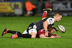 Johnny McNicholl of Scarlets is tackled by George North of Ospreys<br /> <br /> Photographer Craig Thomas/Replay Images<br /> <br /> Guinness PRO14 Round 11 - Ospreys v Scarlets - Saturday 22nd December 2018 - Liberty Stadium - Swansea<br /> <br /> World Copyright © Replay Images . All rights reserved. info@replayimages.co.uk - http://replayimages.co.uk