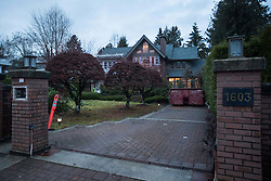 A security guard patrols outside a house owned by Huawei Technologies chief financial officer Meng Wanzhou and her husband, in Vancouver, BC, Canada on Monday, December 10, 2018. The United States is showing its hostility toward Chinese tech giant Huawei by speculating one of its senior executives has avoided travelling there to dodge charges, a lawyer argued Monday at B.C. Supreme Court. Photo by Darryl Dyck/CP/ABACAPRESS.COM