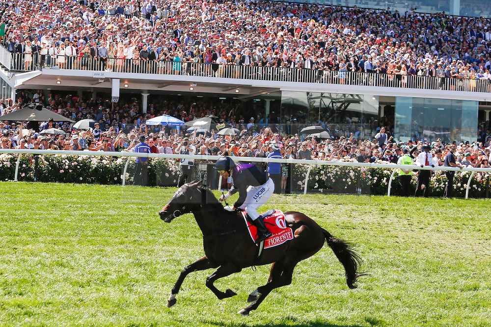 © Licensed to London News Pictures. 5/11/2013. Damien Oliver riding Fiorente wins the Emirates Melbourne Cup during Melbourne Cup Day at Flemington Racecourse on November 5, 2013 in Melbourne, Australia. Photo credit : Asanka Brendon Ratnayake/LNP