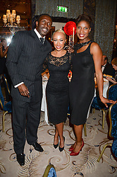 Left to right, LINFORD CHRISTIE, EMELI SANDE and DENISE LEWIS at the inaugural Stephen Lawrence Memorial Ball held at The Dorchester, Park Lane, London on 17th October 2013.