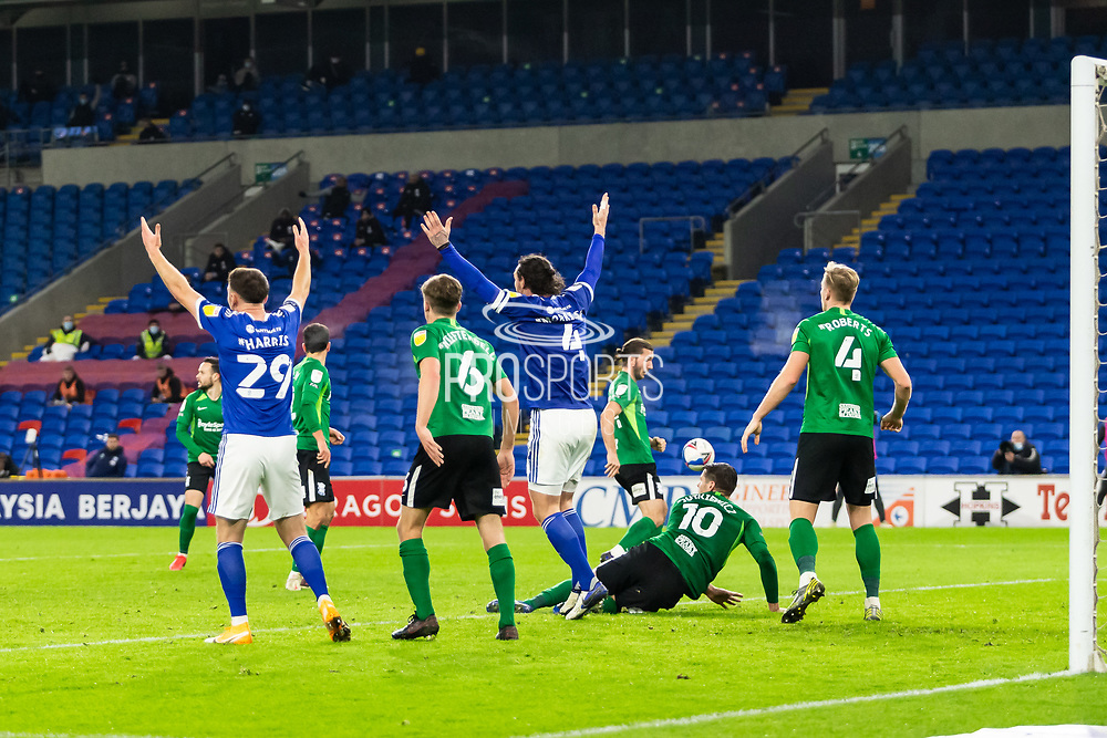 Cardiff City's Mark Harris (29) and Sean Morrison (4) both appeal for a penalty during the EFL Sky Bet Championship match between Cardiff City and Birmingham City at the Cardiff City Stadium, Cardiff, Wales on 16 December 2020.