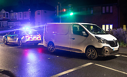 © Licensed to London News Pictures. 08/02/2019. Cheam, UK. Police guard a white van outside Cheam Leisure Centre where a man was detained by armed officers. The leisure centre is 680 metres from where a woman in her 30's was stabbed to death at 3pm on Friday. Two men have been arrested. Photo credit: Peter Macdiarmid/LNP