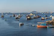 Fishing boats moored in Guanabara Bay in the Urca neighborhood in Rio de Janeiro, Brazil.