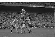 Kerry play lifts teammate to grab the ball as Dublin players approach them during the All Ireland Senior Gaelic Football Final Dublin v Kerry in Croke Park on the 26th September 1976. Dublin 3-08 Kerry 0-10.