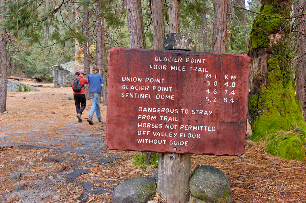 Hikers and sign on the Four Mile Trail to Glacier Point, Yosemite Valley, Yosemite National Park, California