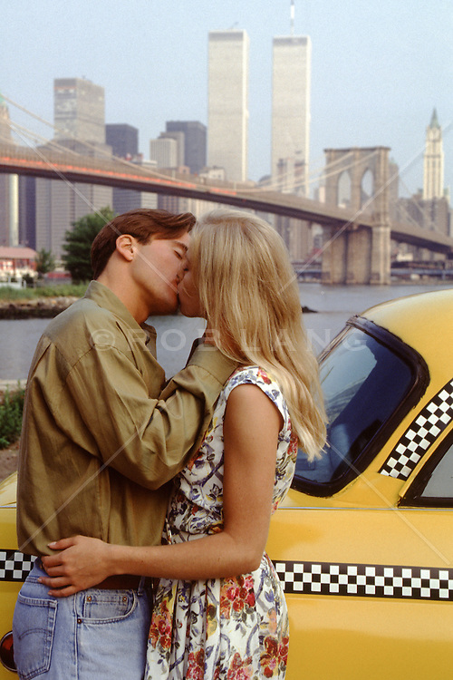 couple kissing overlooking The World Trade Center in New York City