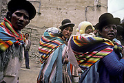 Aymara indian mothers carry their baby children on their backs, Llallagua mining town, Bolivia