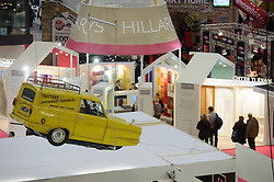 © Licensed to London News Pictures. 15/03/2013 London, UK. Dell Boy's Reliant Robin hangs above the Only Fools and Horses Re Fit stand at The Ideal Home Show 2013 at  Earls Court, London. Celebrity designer George Clarke has given the Trotters famous Peckham flat a modern makeover..Photo credit : Simon Jacobs/LNP