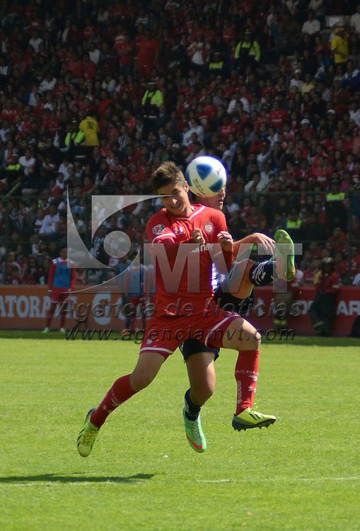 Toluca, México.- Isaac Brizuela durante el encuentro disputado entre los Diablos Rojos del Toluca y Rayados de Monterrey, con marcador de 2-0 a favor del equipo escarlata, correspondiente a la jornada 4 del Torneo de Clausura 2014. Agencia MVT / Crisanta Espinosa