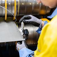 June 2018 TATA Steel - Gelshenkirchen Distribution Centre steel worker measuring tolerances on steel plate