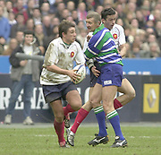 Saint-Denis, Paris, France, 23rd February 2003,  Six Nations Rugby International, France vs Scotland, Stade de France,<br /> [Mandatory Credit: Peter Spurrier/Intersport Images],<br /> Photo Peter Spurrier<br /> 23/02/2003<br /> Sport -SIX NATIONS RUGBY - France v Scotland<br /> Ref - Peter Marshal obstruct's Clement Pointrenuad as he supports  Francois Gelez as he runs across the field,