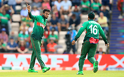 Bangladesh's Shakib Al Hasan (left) celebrates taking the wicket of Gulbadin Naib (not pictured) during the ICC Cricket World Cup group stage match at The Hampshire Bowl, Southampton.