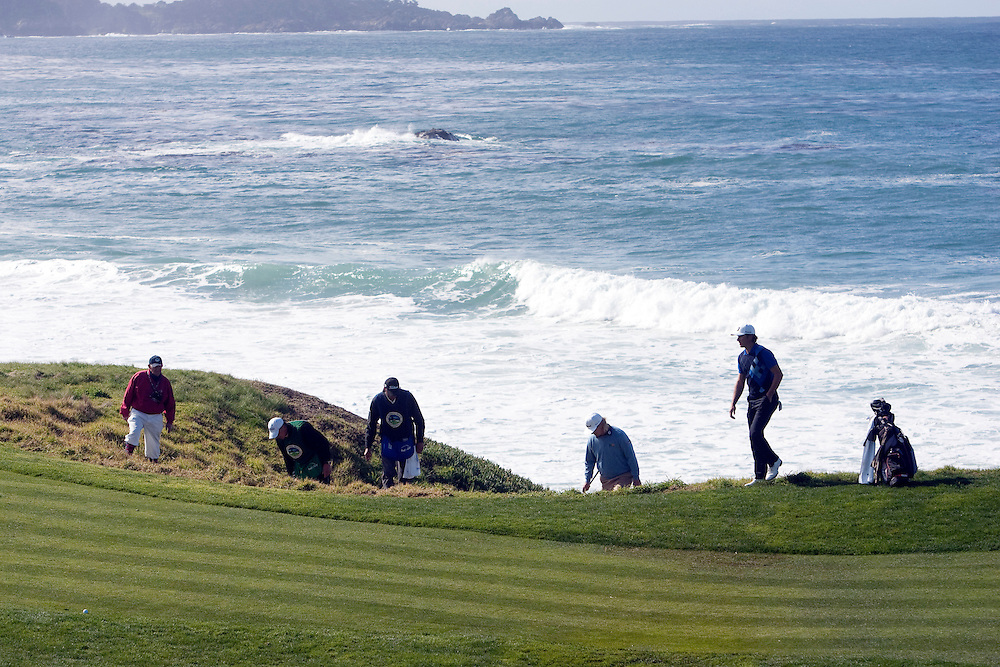 Charley Hoffman, 3rd from right, and partners look for an errant shot at Pebble Beach.