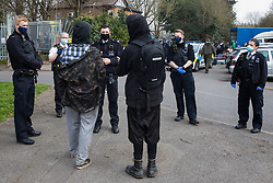 Sipson, UK. 8th March, 2021. Metropolitan Police officers take part in an operation to evict residents from the remaining section of a squatted off-grid eco-community garden known as Grow Heathrow. Grow Heathrow was founded in 2010 on a previously derelict site close to Heathrow airport in protest against government plans for a third runway and has since made a significant educational and spiritual contribution to life in the Heathrow villages which are threatened by airport expansion.