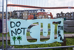 London, UK. A sign objecting to Southwark Council's plans to develop Peckham Green as public housing is displayed on security fencing around the site. Peckham Green is a 1.4-acre public park off Peckham High Street, one of the most polluted roads in London, in a borough which is ranked fifth-worst in London and eighth-worst in the UK for easy access to green space, and local residents and campaigners have been protesting that they were not consulted by Southwark Council in relation to its plans.