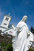 USA, Alaska, A satue of the virgin Mary in front of the Saint Rose of Lima Catholic Church,Wrangell.