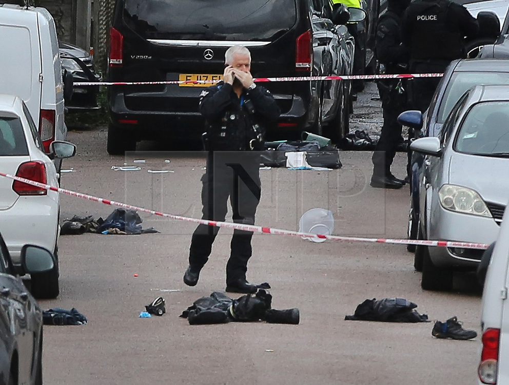 © Licensed to London News Pictures. 23/09/2020. London, UK. Police clothing items including shoes are seen on Dale Close in Barnet, north London, where around 10 police officers were injured in an acid attack after a drugs raid. Around 1.50pm this afternoon, the officers attended an industrial area to executed a drugs warrant as part of a proactive operation and were attacked with acid. Photo credit: Dinendra Haria/LNP