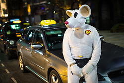 © Licensed to London News Pictures . 27/12/2017. Wigan, UK. Danger Mouse taxi driver . Revellers in Wigan enjoy Boxing Day drinks and clubbing in Wigan Wallgate . In recent years a tradition has been established in which people go out wearing fancy-dress costumes on Boxing Day night . Photo credit: Joel Goodman/LNP