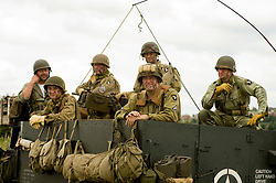 """Re-enactors portraying the American 101st Airborne """"Screaming Eagles"""" advancing during a large scale battle re-enactment. SPAM 1940's Weekend. Heckmondwyke near Wakefield 10 July 2010<br /> Images © Paul David Drabble"""