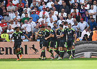 GOAL CELEBRATION - Wales's Gareth Bale (right) celebrates scoring his sides first goal with team-mates<br /> <br /> Photographer Kevin Barnes/CameraSport<br /> <br /> International Football - 2016 UEFA European Championship - Group B - England v Wales - Thursday, 16th June 2016 - Stade Bollaert-Delelis, Lens Agglo, France<br /> <br /> World Copyright © 2016 CameraSport. All rights reserved. 43 Linden Ave. Countesthorpe. Leicester. England. LE8 5PG - Tel: +44 (0) 116 277 4147 - admin@camerasport.com - www.camerasport.com