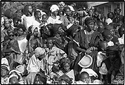 All who live under the sun are plaited together like one big mat.  African proverb<br /> <br /> Well-dressed young women from the John F. Kennedy Lycee For Girls were attending a special program commemorating the anniversary of the death of the late U.S President for whom their school was named. Dakar, Senegal 1988