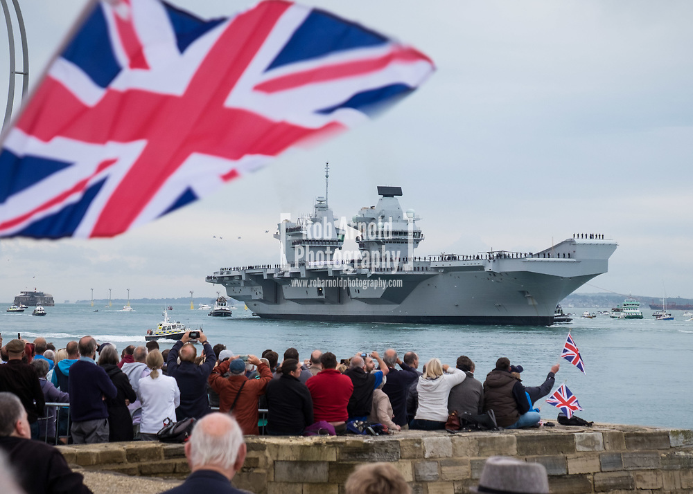 The Royal Navy's new aircraft carrier HMS Queen Elizabeth arrives into Portsmouth Harbour for the first time. Thousands of people lined the shores of Portsmouth and Southsea to welcome the Royal Navy's newest and largest ever ship into her home port.