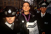 The gay and human rights activist Peter Tatchell is arrested by Met police officer. Peter Tatchell has been campaigning for human rights, democracy, LGBT freedom and global justice since 1967. He is a member of the queer human rights group OutRage!, and the left-wing of the Green Party. Peter is also the Green Party's spokesperson on human rights. Through the Peter Tatchell Foundation, he campaigns for human rights in Britain and internationally. Source http://www.petertatchell.net
