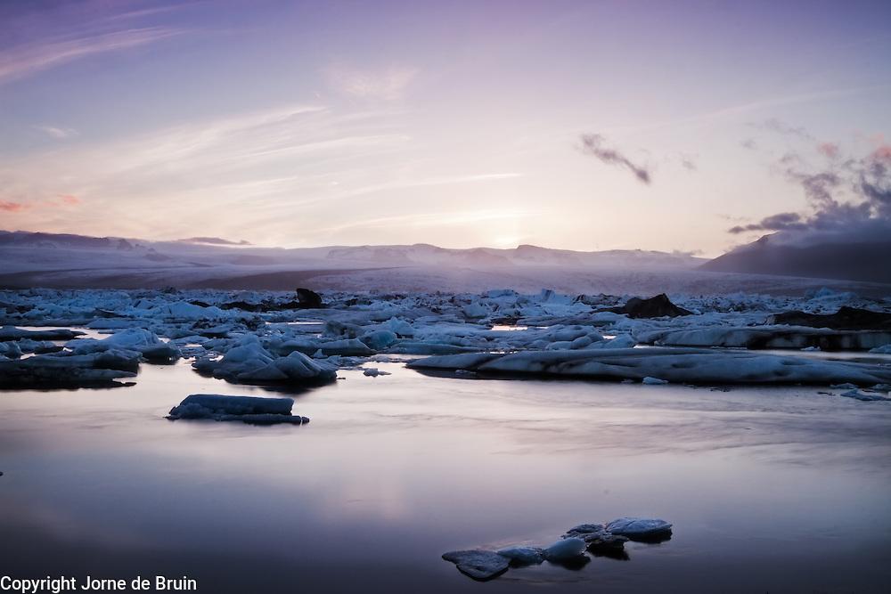 A view of the Jökulsárlón glacier lake at sunset.