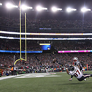 FOXBOROUGH, MASSACHUSETTS - JANUARY 14:  Tight end C.J. Fiedorowicz #87 of the Houston Texans fails to hold a catch in the end zone while challenged by strong safety Patrick Chung #23 of the New England Patriots during the Houston Texans Vs New England Patriots Divisional round game during the NFL play-offs on January 14th, 2017 at Gillette Stadium, Foxborough, Massachusetts. (Photo by Tim Clayton/Corbis via Getty Images)