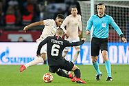 Manchester United Forward Marcus Rashford tackles Marco Verratti of Paris Saint-Germain during the Champions League Round of 16 2nd leg match between Paris Saint-Germain and Manchester United at Parc des Princes, Paris, France on 6 March 2019.