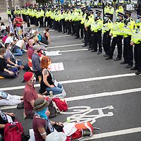 Buddhists and Christians sat to pray and meditate in front of a cordon of police in Parliament Square during Extinction Rebellion demonstrations urging the government to take action on climate change. Ecumenical group Christian Climate Action, with members from WCC members the Church of England and the Methodist Church, among others, took part.