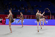 Team Slovakia performs in group tournament with clubs and hoops during Rhythmic Gymnastics World Cup of Pesaro May 29, 2021.