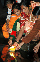 India, Nasik, 2006. A Hindu family sends prayers into the Ramkund, which holds water from the Godavari River.